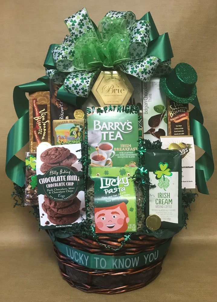 "A large St. Patrick's Day themed basket, all decorated with a St Patrick's Day bow and enhancements. It is chock full of goodies for sharing. Includes coffee, tea, cookies, chocolates, cheese, crackers, chips, pretzels and more. Includes a free ribbon banner that says ""I'm Lucky To Know You! Great corporate client gift, thank you gift, raffle prize or party basket. Items of equal or greater value may be substituted depending on availability."
