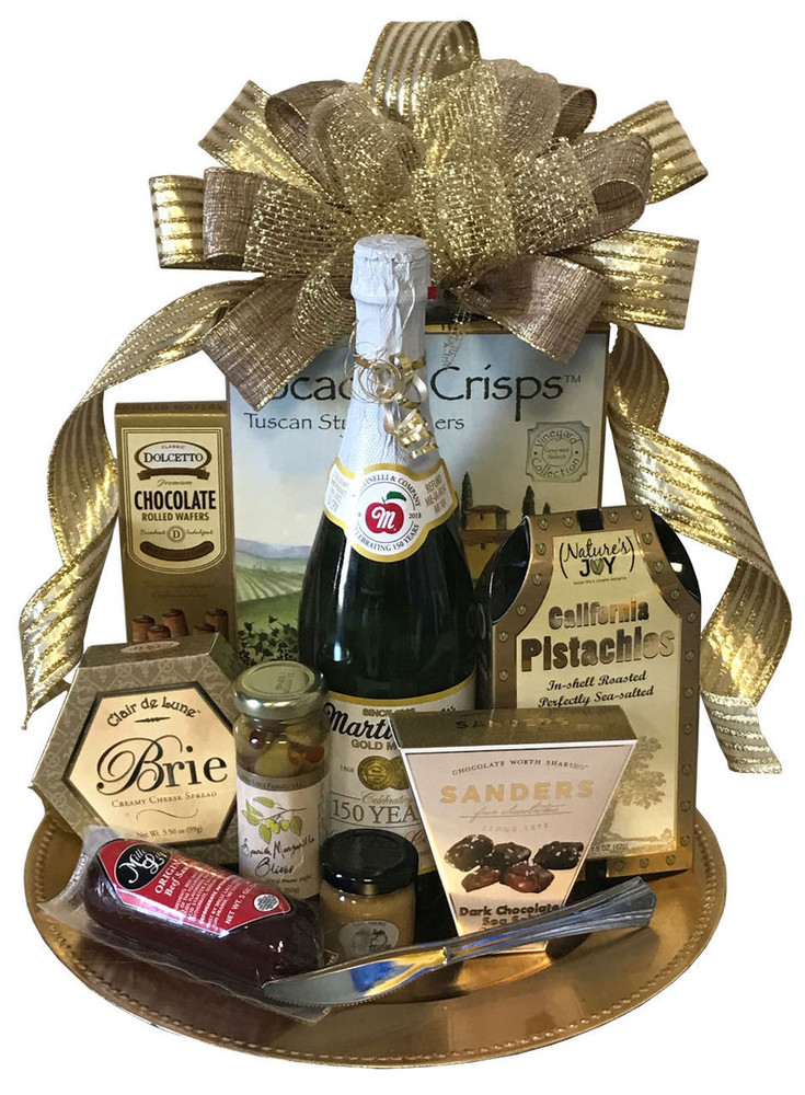 The price includes sparkling cider for those who want a non alcoholic version. Also includes Brie cheese, focaccia crisps, sausage, mustard, olives, chocolate sea salt caramels, and cookies on a platter and topped with an elegant bow.