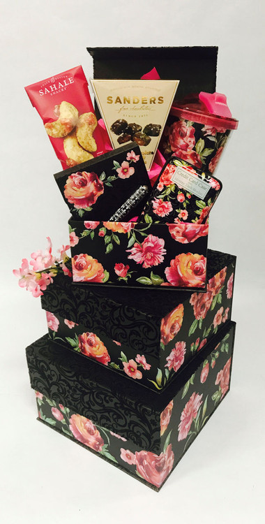 This stunning design will make her feel very special! It includes high end spa items, unique gifts she will enjoy daily, and an assortment of gourmet items.  It is all presented in gorgeous, high end fabric gift boxes with magnetic closures. It will make a beautiful home accent and perfect place to store pictures, keepsakes, scarves, and more. The gift includes matching travel mug, credit card case, and note pad with pen. We have also added an Aromatherapy gift boxed set with a portable diffuser, tea, chocolates, cookies, confections, dried fruit, and a delicious and savory gourmet items. items of equal or greater value may be substituted depending on availability.