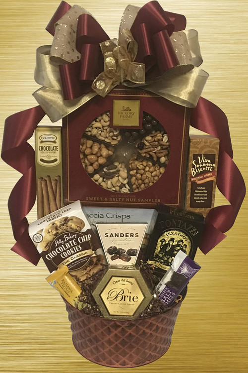 "Designed in a beautiful bronze textured tin, this gift is brimming with delicious gourmet items, nuts and snacks! Includes a large gift boxed nut assortment (chocolate nuts, honey peanuts, roasted & salted whole cashews, roasted mixed nuts, cranberry sesame nut mix, and butter toffee peanuts), honey mustard pretzels, cookies, chocolates, cheese and crackers. A great gift for employees, a whole team to share, clients, host or hostess, friends and family. Makes an impromptu party!  Includes a free ribbon banner with a message of your choice! Message suggestions:  For an employee the banner could say ""We're Nuts About You're Work!""  For a client the banner could say ""We're Nuts About You're Business!""  For a personal thank you or birthday the banner could say ""We're Nuts About You!"""