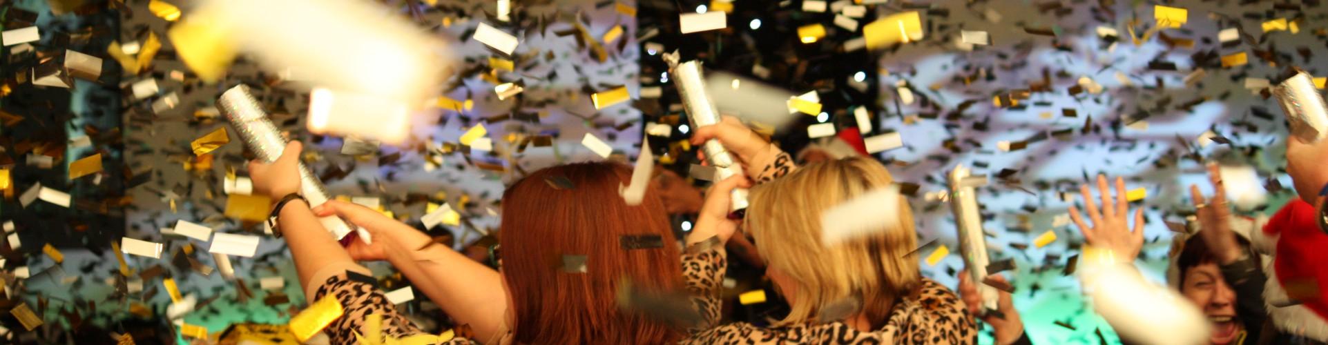 confetti cannons and gold glitter confetti at a party