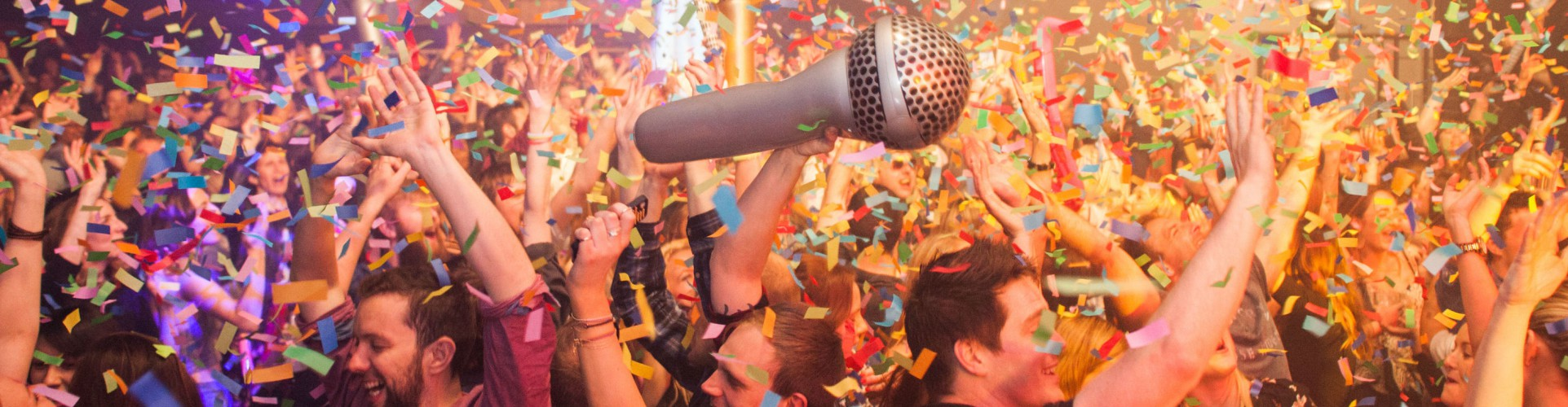 crowd in nightclub dance in multicolour confetti