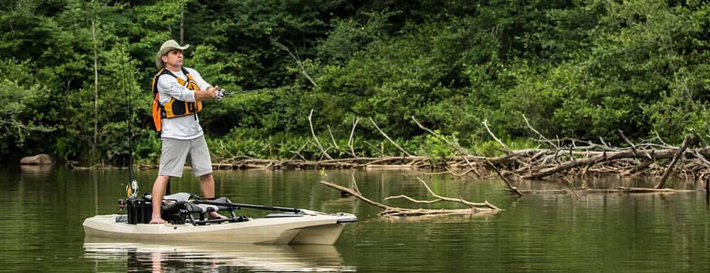 Man standing up on a Bonafide Kayak.