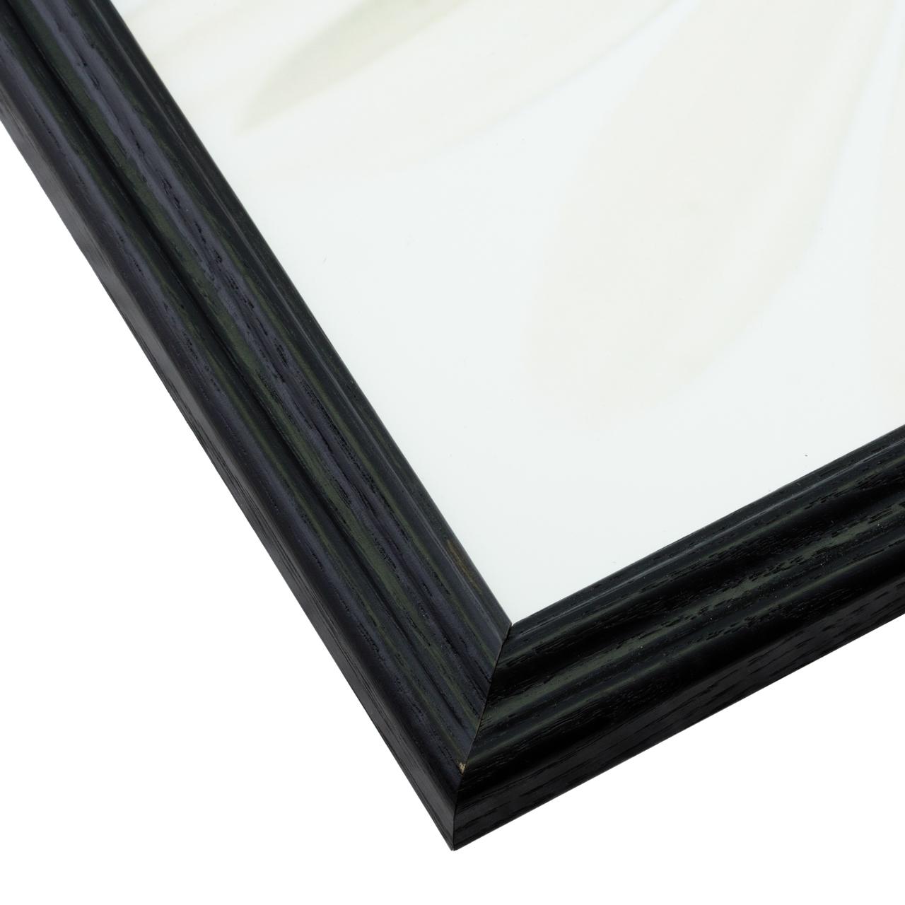 Moulding features unique wood grain patterns stained black.