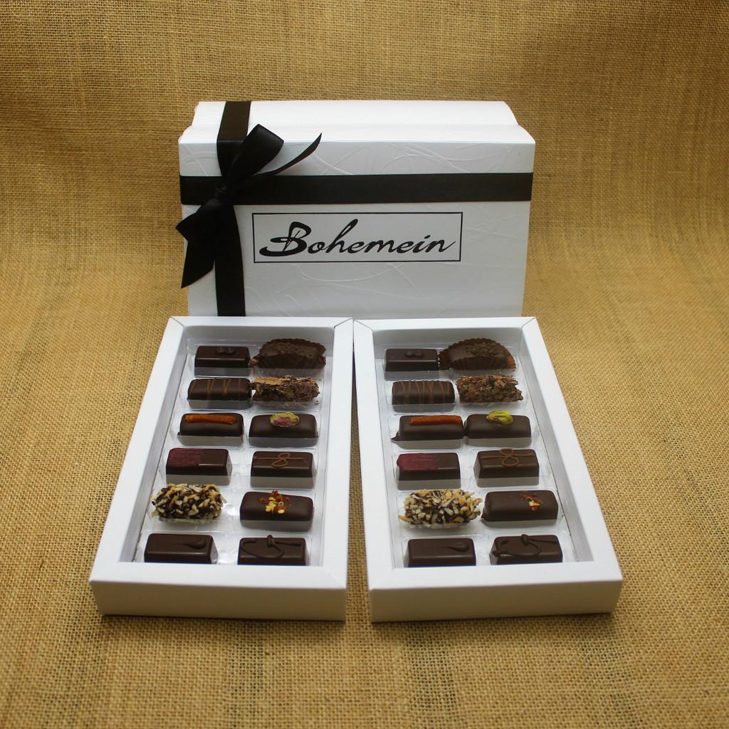 Bohemein 24 Dark  Chocolates Gift Box includes: Melting Passion Ganache x 2, Coconut Cream Truffle x 2, Raspberry Ganache x 2, Rosemary and Apricot Ganache x 2,Noisette (Hazelnut) x 2, Creme de Menthe Fondant x 2, Ginger Caramel x 2, Chilli Ganache x 2, Vanilla Cream - Dark x2, Pistachio Marzipan x2, Seventy Truffle x2, Cocoa Nib Caramel x2