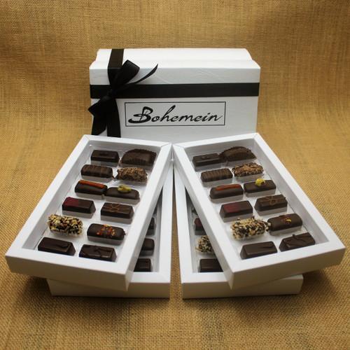 Bohemein 48 Dark  Chocolates Gift Box includes: Melting Passion Ganache x4, Coconut Cream Truffle x4, Raspberry Ganache x4, Rosemary and Apricot Ganache x4,Noisette (Hazelnut) x4, Creme de Menthe Fondant x4, Ginger Caramel x4, Chilli Ganache x4, Vanilla Cream - Dark x4, Pistachio Marzipan x4, Seventy Truffle x4, Cocoa Nib Caramel x4