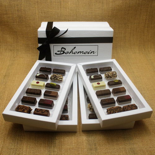 Bohemein Gift Box with 48 Non Alcohol Flavoured Chocolates including: Seventy Truffle x4, Vanilla Cream - Dark x4, Noisette (Hazelnut) x4, Strawberry Ganache x4 ,Pineapple Black Pepper Ganache x4, Ginger Caramel x4, Maple Cream x4, Raspberry Ganache x4, Chocolate Caramel x4, Pistachio Marzipan x4, Coconut Cream Truffle x4, Balsamic Vinegar and Honey Ganache x4