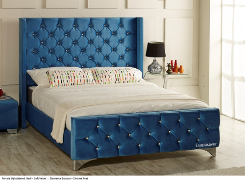 Ferrara upholstered bed shown in soft velvet fabric, chrome feet, and diamante buttons.