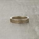 Monhegan nature-inspired twig wedding ring with a single white diamond.
