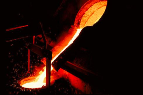 A heavy metallic aroma of heat and industry.