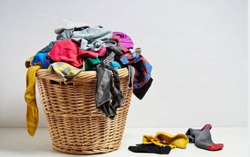 The pungent, muggy aroma of unwashed laundry.