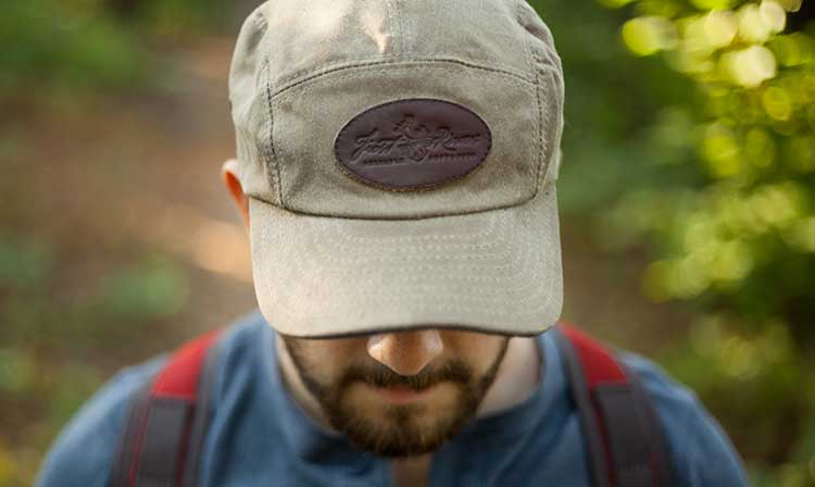 The Frost River 5 Panel waxed cap. The Frost River High Falls Short Day Pack in two-tone, with Olde Glory Red and Field Tan. Available for a limited time at Frost River Trading Co. in Duluth and online at FrostRiver.com. Orders taken through 9/6/2016 for end of September delivery. Photo by Regan Walsh.
