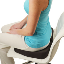Wedged Kabooti Donut coccyx cushion helps support a better seating posture