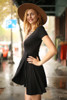Flirty and Flawless Black Fit and Flare Wrap Dress side view.