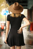 Flirty and Flawless Black Fit and Flare Wrap Dress back view.