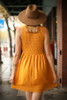 Bold in Mustard High Neck Babydoll Dress back view.