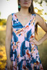 Tropical Vibes Pink Floral Printed Midi Dress detail view.