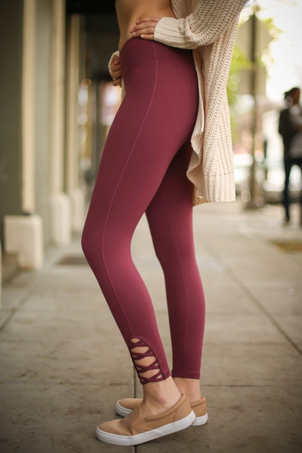 Activated Athletics Deep Plum Leggings with Crossed Detail side view.
