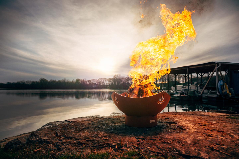 Fabulous sunset by fire pit art.