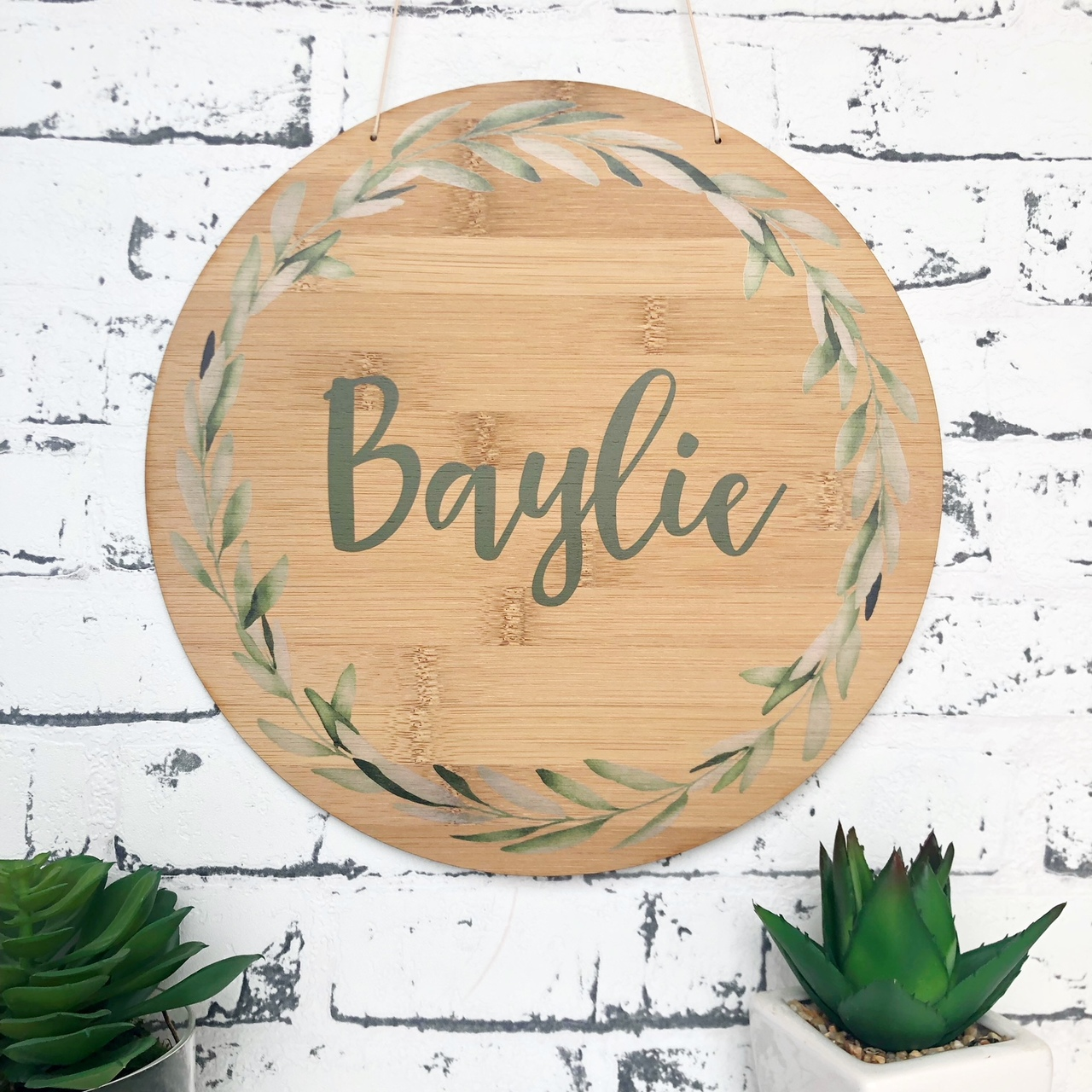 A Personalised watercolour olive branch bamboo plywood wall hanging