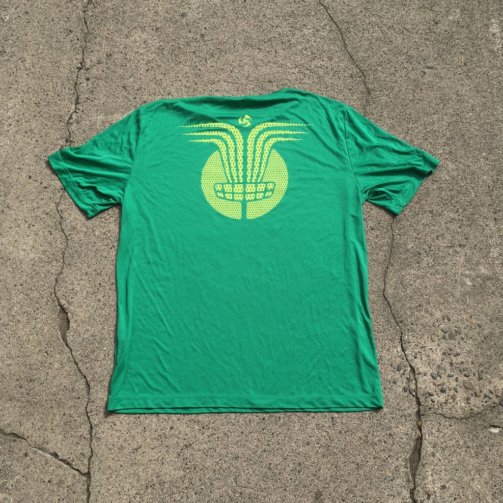 Kelly green tee with neon Huk Lab Chain Ray back graphic