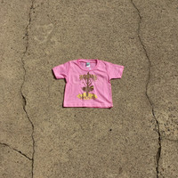 "Precious Cargo organic pink tee with Huk Lab ""born to fly"" graphic"