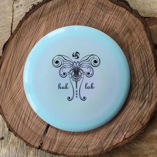 Innova Star Destroyer light blue with a black Huk Lab GEN 004