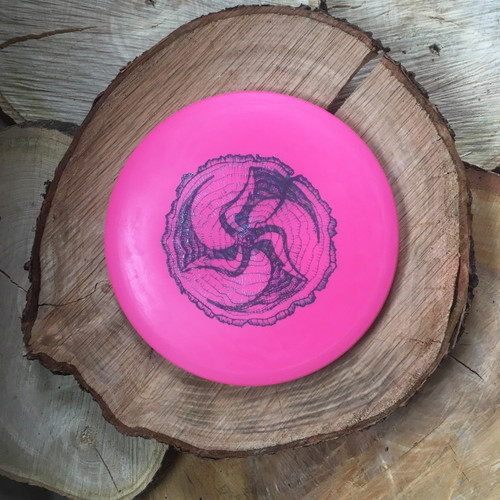 Innova DX Roc pink with a Huk Lab Timber stamp