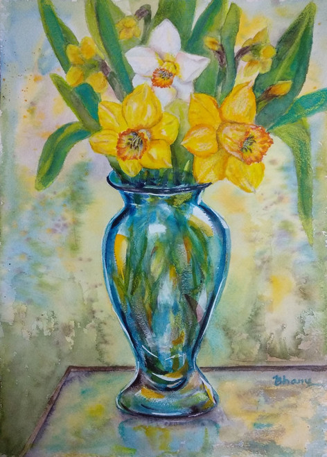 Buy Blue Glass Vase Of Daffodils On Glass Table In The Garden