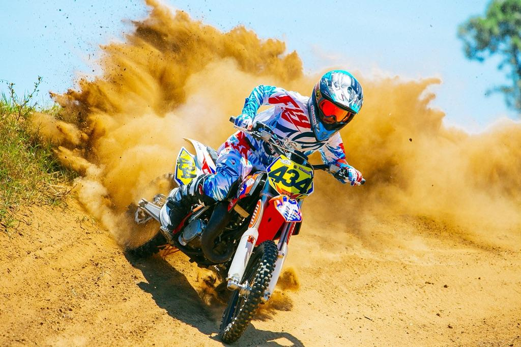 jack mather riding his KTM 85 blowing berms