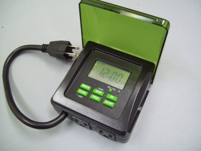 Outdoor approved digital timer for operation of super feeder with outdoor power supply