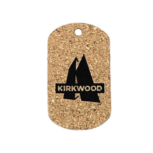 Vertical oriented custom cork dog tag with single blank logo color printed on surface. Logo is Kirkwood.