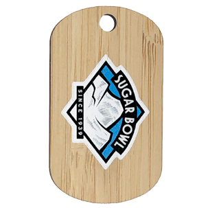 Custom bamboo dog tag with sugar bowl ski resort logo imprinted on the front.