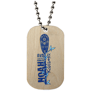 Our custom wooden dog tags custo made for Noah Kalama. It has a blue and light logo carved and color filled on one side.
