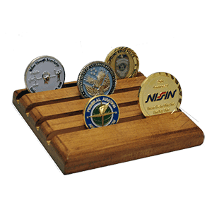 Wodden challenge coin display that is flat, not tiered, with four rows. Can hold up to 16 challenge coins that are 1.5