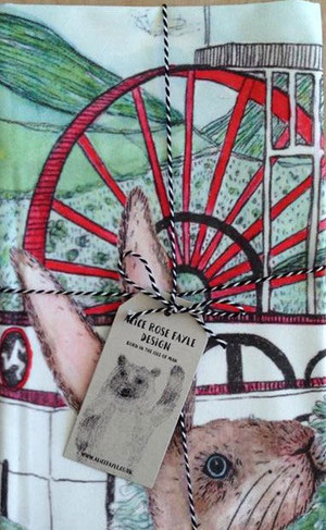 Hare and Laxey Wheel T Towel designed by Alice Rose Fayle - folded