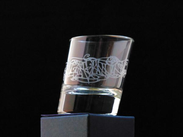 A single slanted shot glass with Julia Ashby Smyth's Ellan Vannin design - empyt