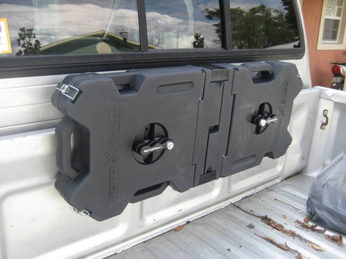 2 x Black Storage containers mounted side x side on truck bed.