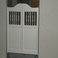 White Spindles Bathroom Doors