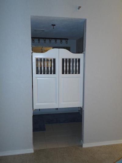 swinging-bathroom-doors.jpg