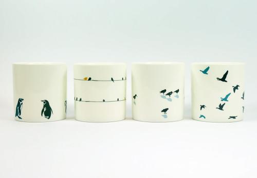 Set of four Bird bone china mugs by Jacky Al-Samarraie