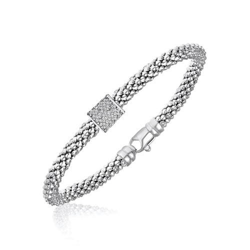 Sterling Silver Rhodium Plated Diamond Embellished Popcorn Bangle (.13ct tw)