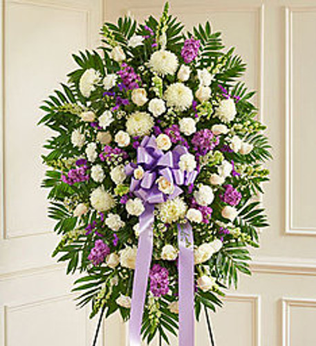 When you want to send a sympathy arrangement that celebrates a beautiful and unforgettable life, this lavender and white standing spray is a heartfelt choice. Expertly crafted by our florists from an assortment of the freshest blooms, it's a lovely expression of your love and devotion during a difficult time.