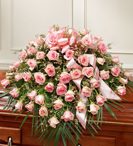 """•Features gorgeous long stem pink roses, waxflower and vibrant greenery •Traditionally sent by the immediate family to the funeral home •Our florists use only the freshest flowers available, so colors and varieties may vary •Arrangement measures approximately 16""""H x 28""""W x 36""""L"""