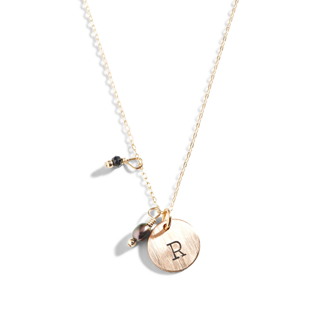 Gold initial disc necklace tiny gold disc necklace with initial she wears black gold initial necklace aloadofball Gallery