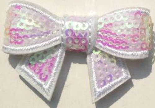 White Sequin bows for small children. Our Sequin bows Shine in your hair and look spectacular.