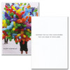 """Business birthday card Cover is Photo of balloon vendor with the text """"Happy Birthday"""" Inside of card has Black lettering on white background with the text: """"Sending you all the good wishes you can hold in your arms"""""""