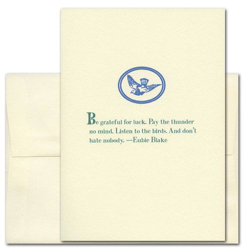 "Quotation Card ""Be Grateful: Blake"" Cover shows blue vintage illustration of bird framed with an oval border with a quote by Eubie Blake: ""Be grateful for luck. Pay the thunder no mind. Listen to the birds. And don't hate nobody."""