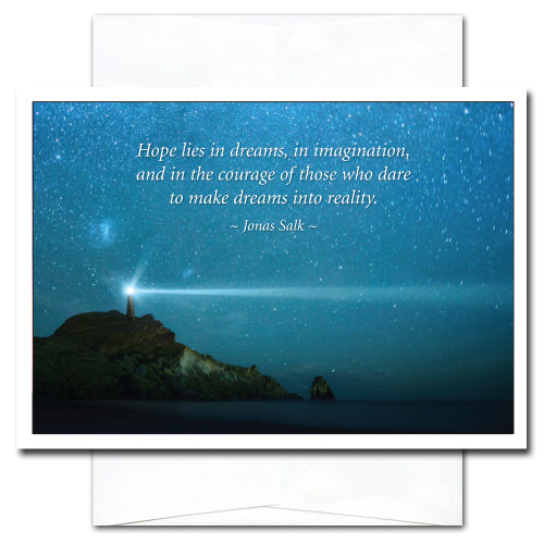Beacon New Year Card shows a lighthouse against a starry sky with the quote: Hope lies in dreams, in imagination, and in the courage of those who dare to make dreams into reality. – Jonas Salk