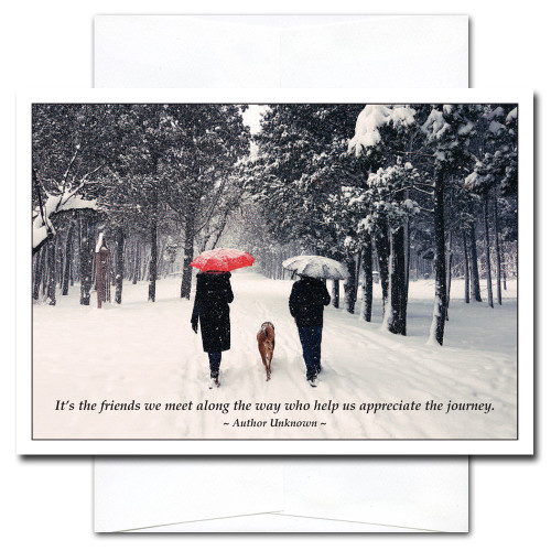Good Friends New Year Card shows a couple and a dog walking in the snow with the quote: It's the friends we meet along the way who help us appreciate the journey - Author Unknown